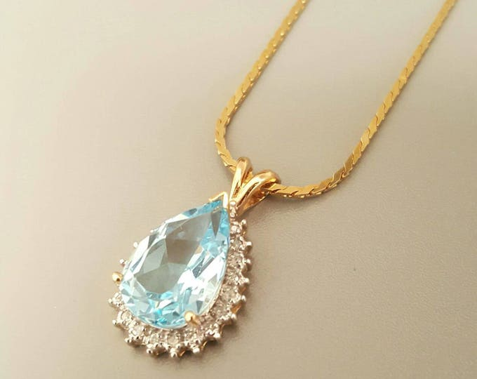 Yellow Gold Blue Topaz and Diamond Pendant. The Necklace Chain is Sold Separate. Free U.S. Shipping. International Charges May Vary.