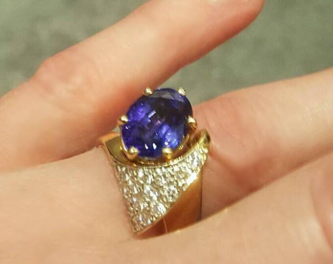 Hallmarked 14K Yellow Gold Tanzanite and Diamond Ring. Beautiful Bright Tanzanite with Sparkling Full Cut Diamonds. Gorgeous Statement Ring