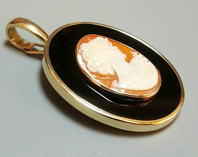 14K Yellow Gold Shell Cameo and  Onyx Pendant Enhancer. 14K Omega Necklace Sold Separate. Other Necklaces are Available Also.