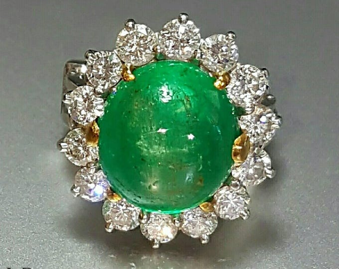 Platinum Accented with 18 Karat Yellow Gold Emerald and Diamond Ring.