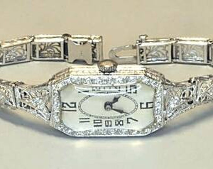 14K White Gold Diamond Wristwatch. Keeps time and is in Very Good Condition.
