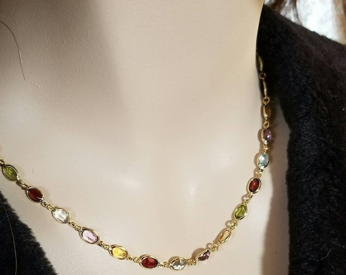 Hallmarked Le Gi, Italy, 14K Yellow Gold Multi Gemstone Necklace. Garnets, Amethyst, Citrine, Blue Topaz, Peridot with a Lobster Claw Clasp