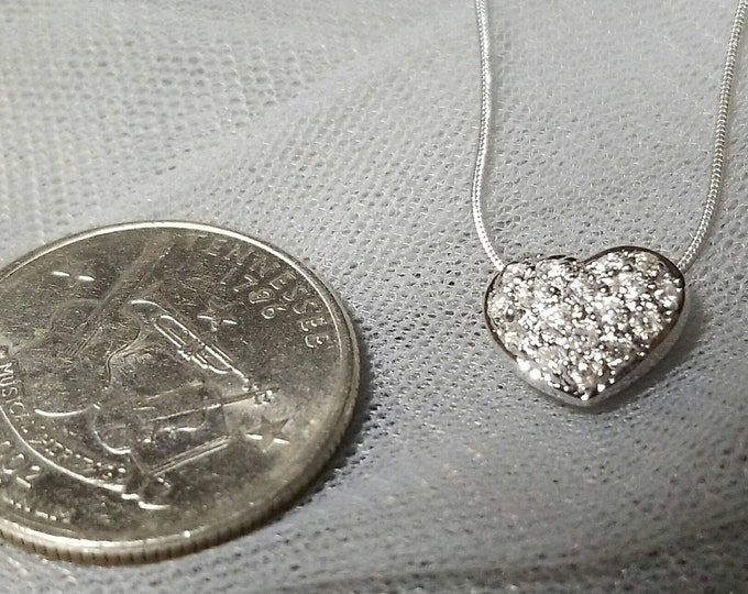 Marked 14K White Gold Heart Shaped Diamond Pendant on a 14K White Gold Snake Style Chain with a Lobster Claw Clasp