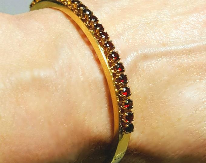 14 Karat Yellow Gold Hinged Style Garnet Bangle Bracelet.
