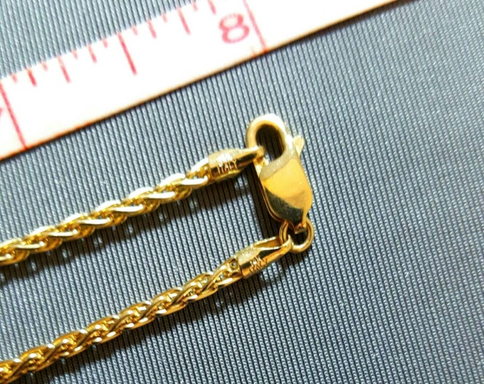 14K Yellow Gold 16 Inch Wheat Style Chain. Fine Quality, Strong Pendant Chain or Can Be Worn Alone as a Necklace. Has a Lobster Claw Clasp.