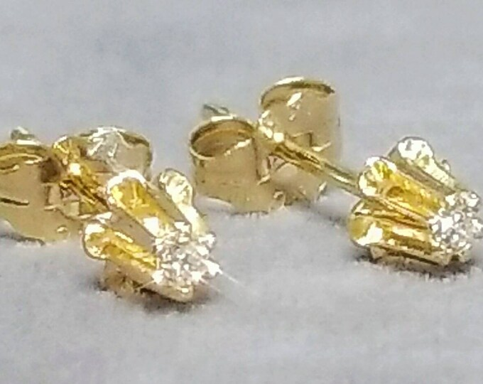 Pair of 14 Karat Yellow Gold Buttercup Style Pierced Diamond Earrings.