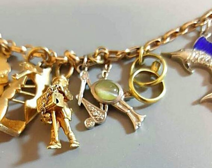 Beautiful Vintage 14K and Platinum Charm Bracelet. Some Rare and all Unique Charms Memories from the Past. Cats Eye Gem and Diamond Charms