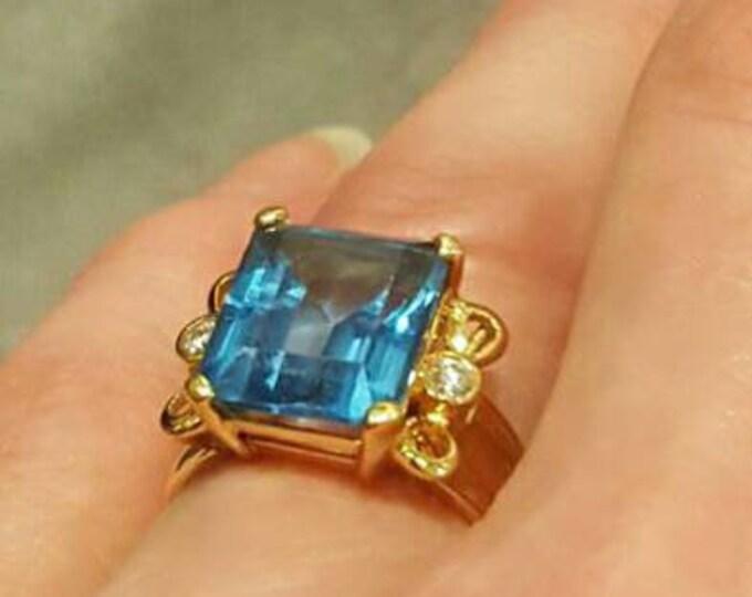 14 Karat Yellow Gold Blue Topaz and Diamond Ring.