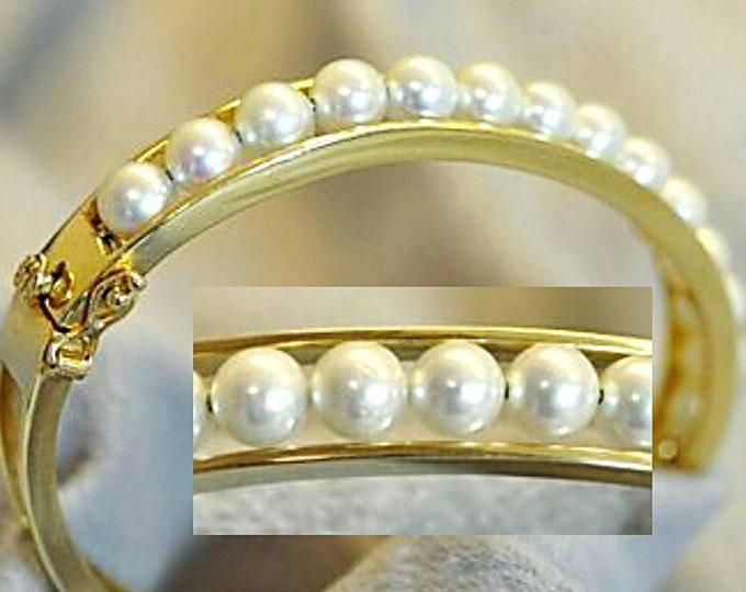 14 Karat Yellow Gold Akoya Cultured Pearl Hinged Style Bangle Bracelet.