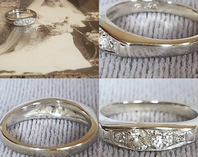 PRICE REDUCED....14 Karat White Gold Diamond Ring. Custom made with a Selection of Older cut Diamonds.  Well made in Excellent condition.