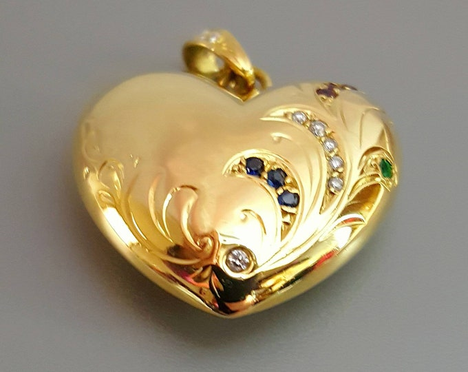 18K Yellow Gold, Diamond, Emerald, Ruby and Sapphire Heart Pendant. With an Enhancer Bail to Wear with Many Different Necklaces Available.
