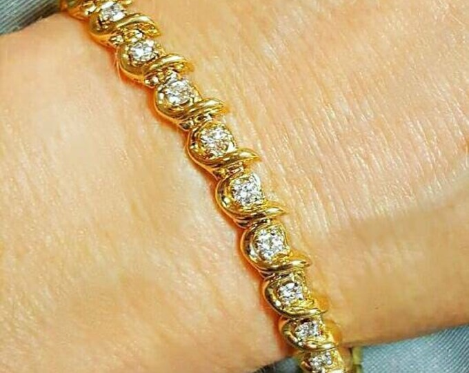 14 Karat Yellow Gold Diamond Bracelet.