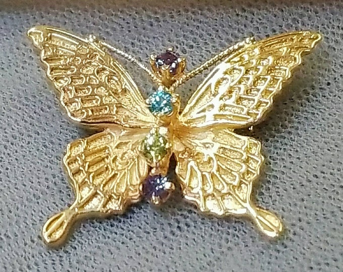 Marked 14K Yellow Gold Butterfly Pendant Brooch set with Gemstones Accented with a Textured Finish