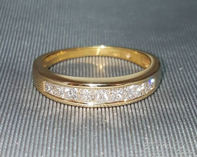 Hallmarked 14 Karat Yellow Gold Princess Cut Diamond Band Style Ring.