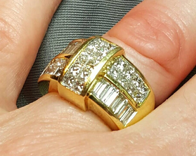 18 Karat Yellow Gold Invisible Channel Set Diamond Ring.