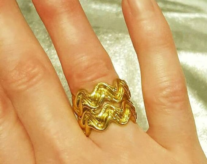 Two 18 Karat 750 Yellow Gold Matching Tiffany and Co. Rings. The Diamond Ring is Sold Separately.