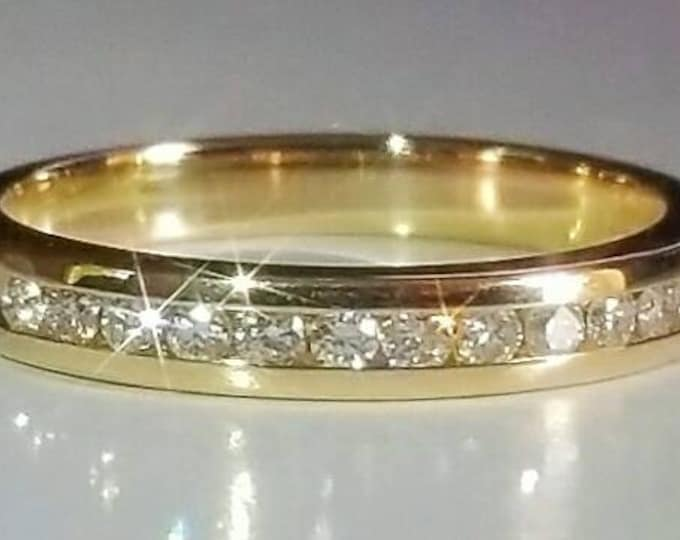 PRICE REDUCED...Hallmarked 14K Yellow Gold Channel set Diamond Ring. Approx. 0.25 carats. Total Diamond Weight. Well made, Nice Quality.