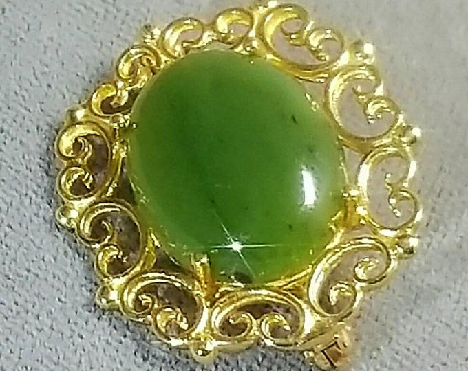 PRICE REDUCED.  14K Yellow Gold Jade Brooch. Nephrite Jade Brooch. Cabochon Cut Jade. Green in Color. Pin with Catch.