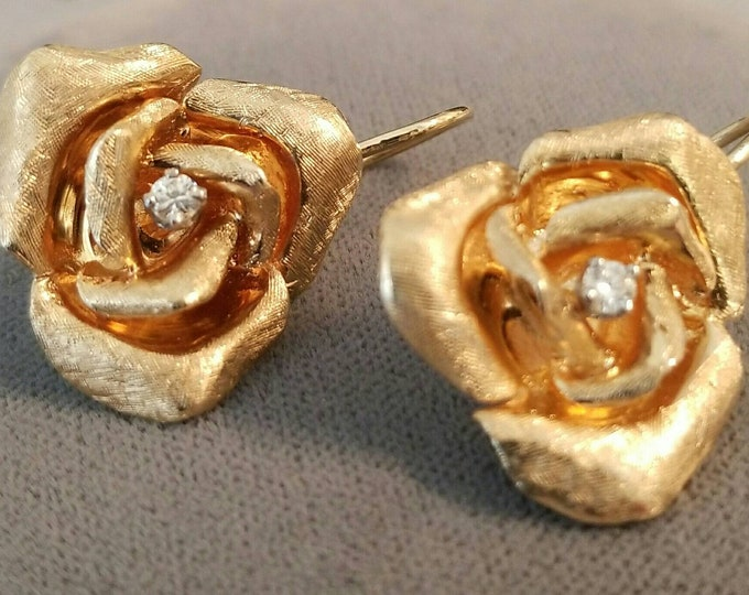 Pair of 14K Yellow Gold 3D Rose Design Top Earrings. Each Earring is set with a Round Full Cut Diamond. Attached are 18K Gold Earring Wires