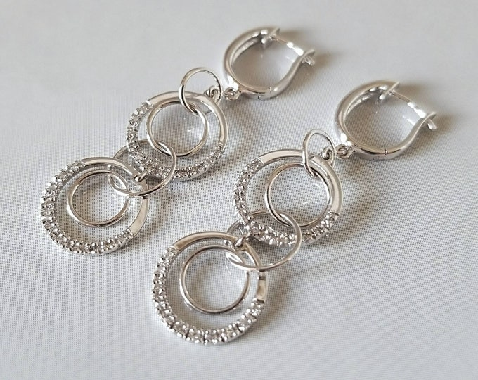 PRICE REDUCED...Or, OFFERS....Pair of Hallmarked 14K White Gold Diamond Earrings. In a Dangle style Accented with Diamonds