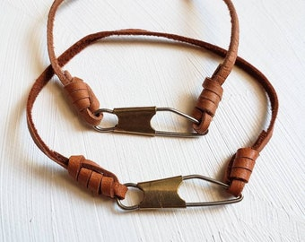 Knotted leather bracelet w/ upcycled fishing snap