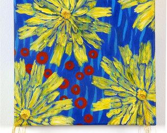 Dandelions on blue water