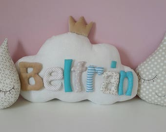 Cushion cloud personalized with name.