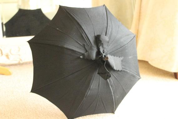 Victorian black cotton folding carriage parasol, l