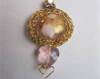 Pink and gold framed heart pendant necklace