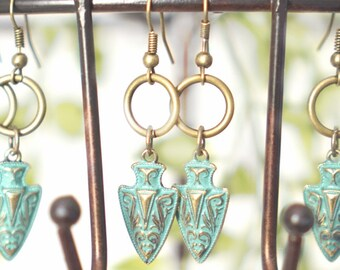 Dangle earrings. Turquoise arrow.