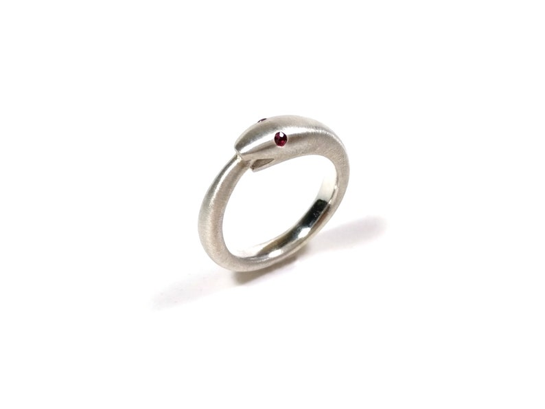 Silver Uroboros ring witha ruby snake biting its tail symbol of infinite rebirth