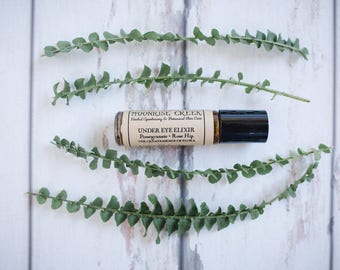 Under Eye Elixir • Pomegranate + Rose Hip • The Quintessence of Flora • Intended to tone, brighten, hydrate, tighten & reduce inflammation