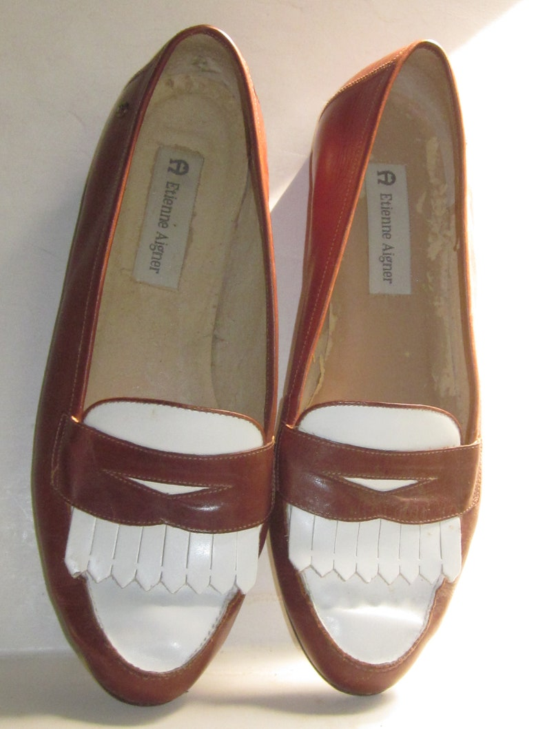 08bd7f98794a5 Vintage ETIENNE AIGNER Brown & White Leather Penny Loafer Slip On with  Kiltie Toe Flats-Heel 1/2