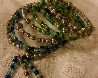 Memory Wire bracelet .Green, Blue and Silver beads