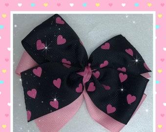 Black with pink hearts pinwheel hair bow