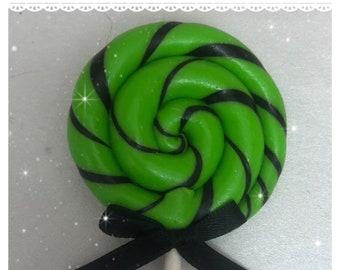Green and black faux lollipop hair clip