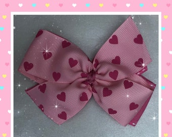 Light pink with bright pink hearts pinwheel hair bow