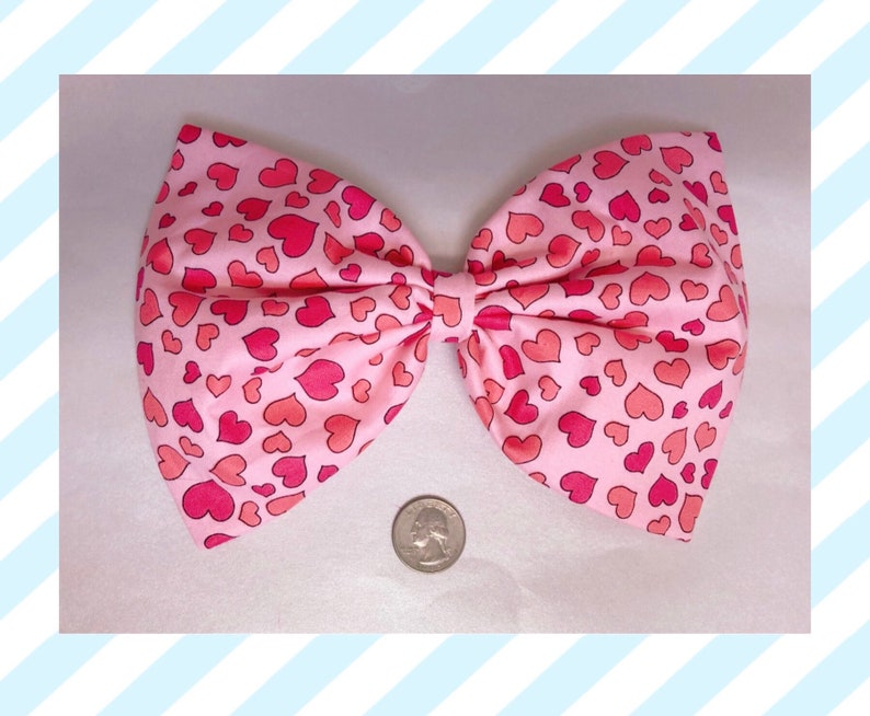 Light pink with pink hearts large hair bow image 0