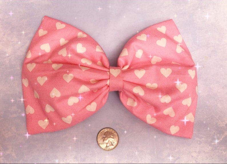 Large pink with white hearts hair bow image 0