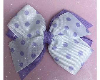 Lavender polka dot pinwheel hair bow