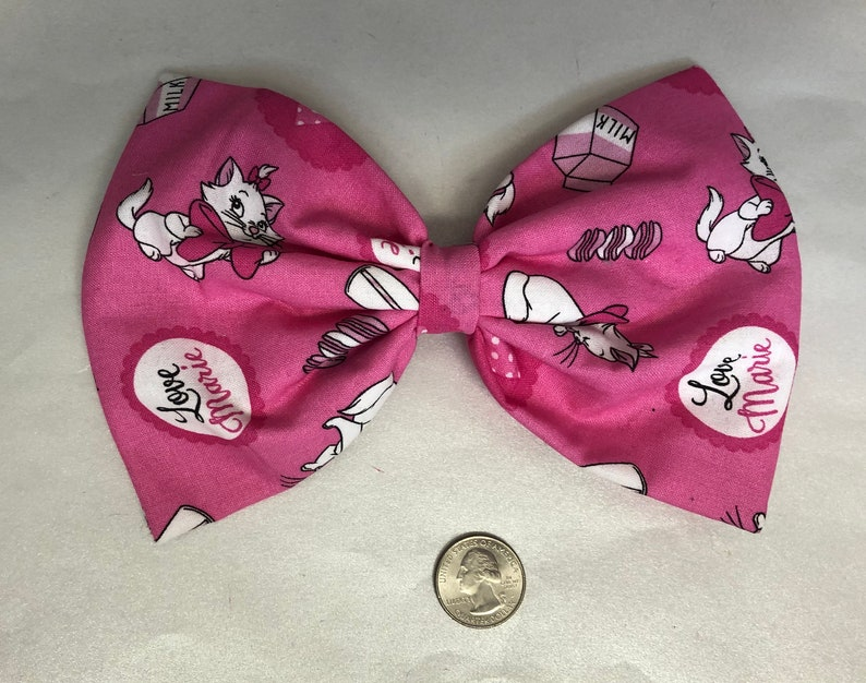 Bright pink Aristocats Marie the cat large hair bow image 0
