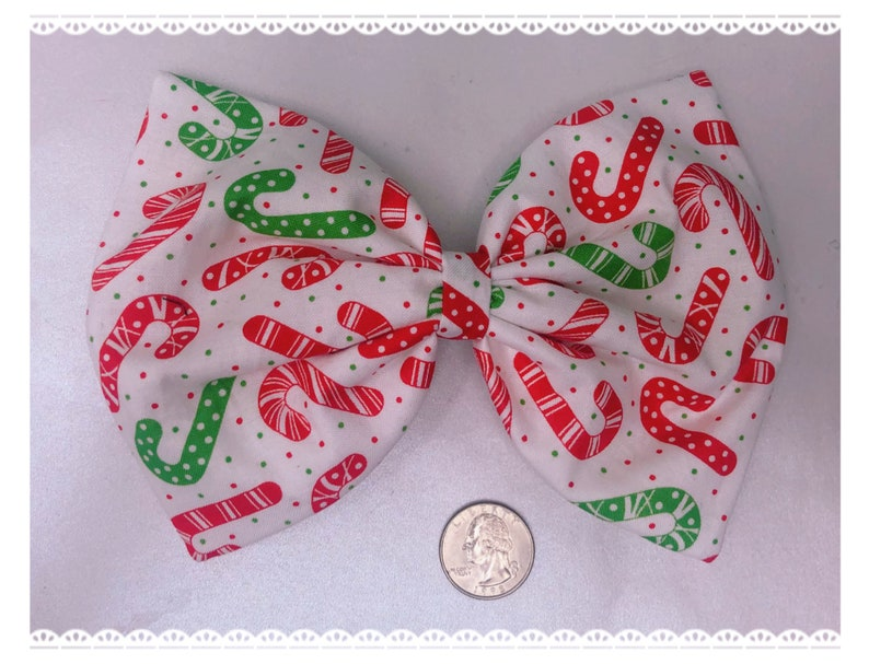 Candy cane holiday large hair bow image 0