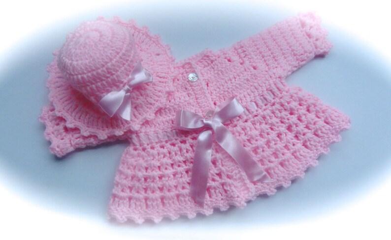 b81e107ef E. Baby girl sweater crocheted matching hat adjustable
