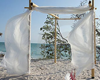 Wedding arch with fabricbamboo chuppahbamboo archbeach bamboo wedding archbeach wedding archbamboo chuppahwedding arch fabric draping junglespirit Image collections