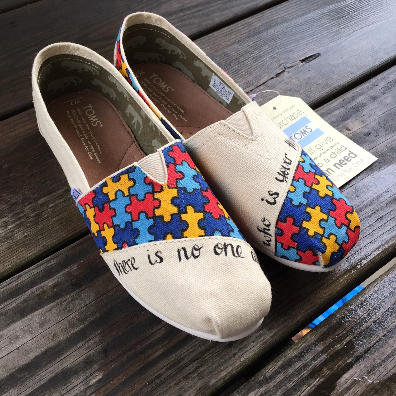 8657ed4fa231a5 Autism Awareness Toms with the quote There is no one
