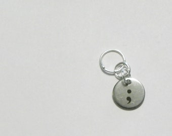 Stainless Steel Semicolon Seamed Ring Stitch Marker.