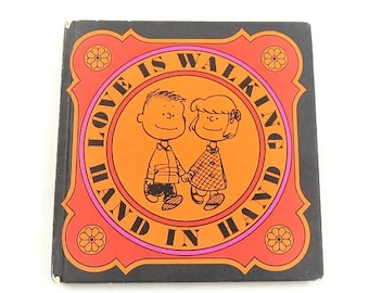 Love Is Walking Hand In Hand By Charles M Schulz Hardcover Square Vintage Book orange black halloween theme love engagement wedding gift
