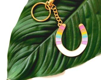 lucky serape horseshoe keychain in glittery rainbow pastel on gold