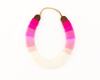 Serape style lucky yarnbombed horseshoe pink ombré