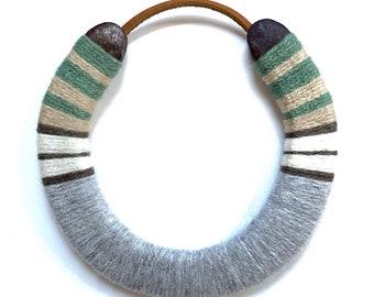 neutral lucky yarn bombed horseshoe sage green/tan/grey